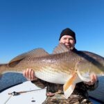 2020 - Jack Salisbury with a beautiful Redfish, caught fly fishing in Louisiana.