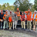 2021 - Members on a quail hunting trip at the Gilchrist Club in northwestern Florida. A few were original members of the Rod & Gun Club that all started in the late 90's. From left to right- John Turner, Jim Davidson, Carmen Sferrazza, Tom Davidson Jr., Alan Goldstein, Tom Davidson Sr., Gus Hillenbrand, Nelson Sims, Bill Legg (behind), Leonard Wood and dog Honey, Bill Nutt.