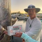 2021 - 391 lb Swordfish caught on Mo Cuisle.  Bud Copeland, with John Weiland and the official weigh-in.